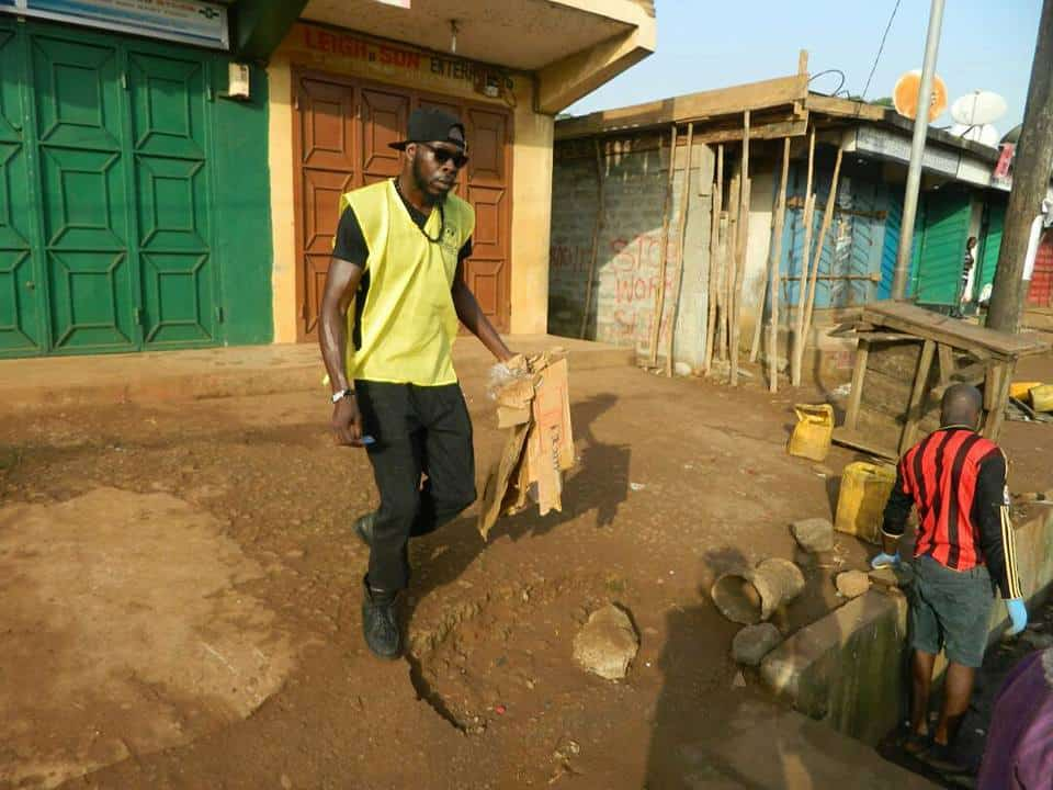 Chief cleaning Calabatown Market in Freetown